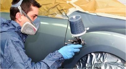 Certified Paint Technician Painting a Fender